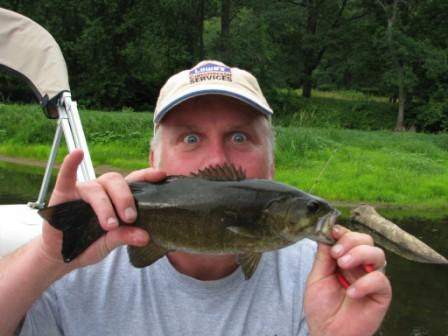 John Nelson with a small mouth bass caught and released on the St. Croix River During 2008 Beijing Olympics