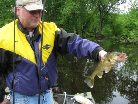 Greg showing his first catch of the 2011 season, St. Croix walleye aka Walter or Wanda