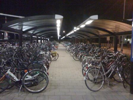 Instead of automobiles lined up a trainstation, its bicycles in Nijkerk
