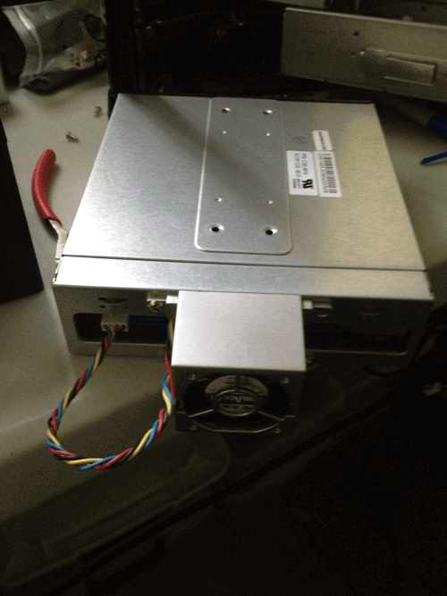 Via StorageIOblog Supermicro 4 x 2.5 rear view CSE-M14TQC 12Gbps SAS enclosure